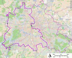 Берлинская стена (сплошной фиолетовой линией) на карте города. Былыми точками отмечены КПП.